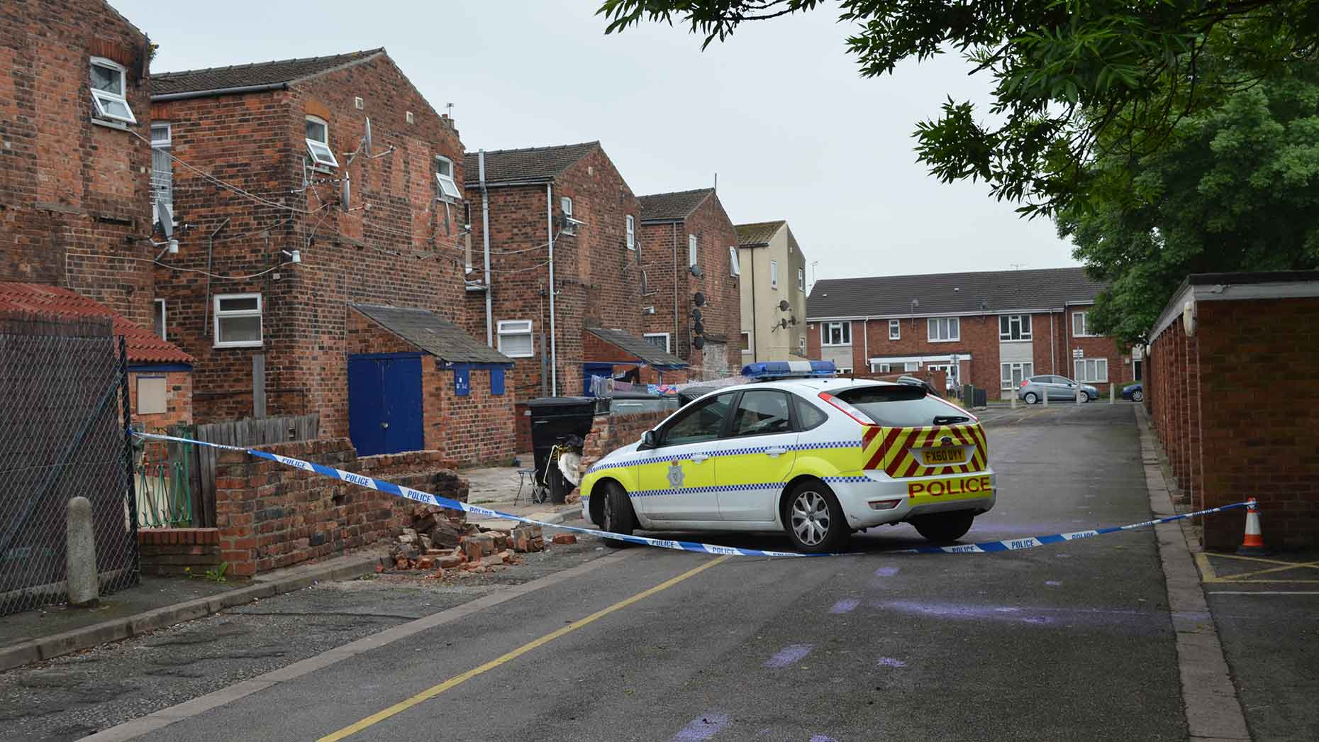 Police officers carry out their enquiries at the back of Portland Street in Lincoln on June 21, 2013.