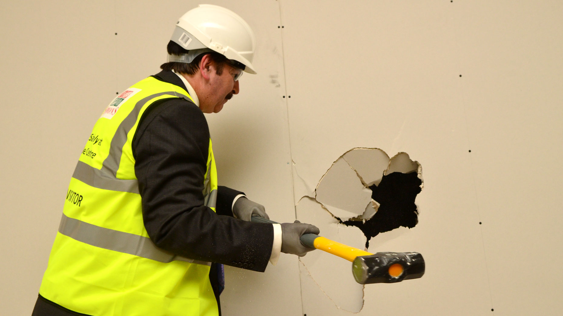 City of Lincoln Council Chief Executive, Andrew Taylor hammers a wall to inaugurate works at the Waterside. Photo: Steve Smailes for The Lincolnite