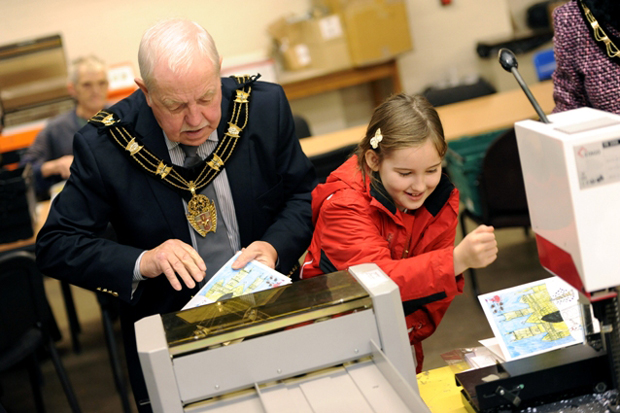 Sarah Robinson, aged 8, joined the Mayor at the Pelican Trust's printing facility. Photo: City of Lincoln  Council
