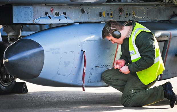 An RAF engineer prepares a Tornado's reconnaissance pod to provide imagery of the Thames Valley area. Photo: Senior Aircraftman Andy Masson