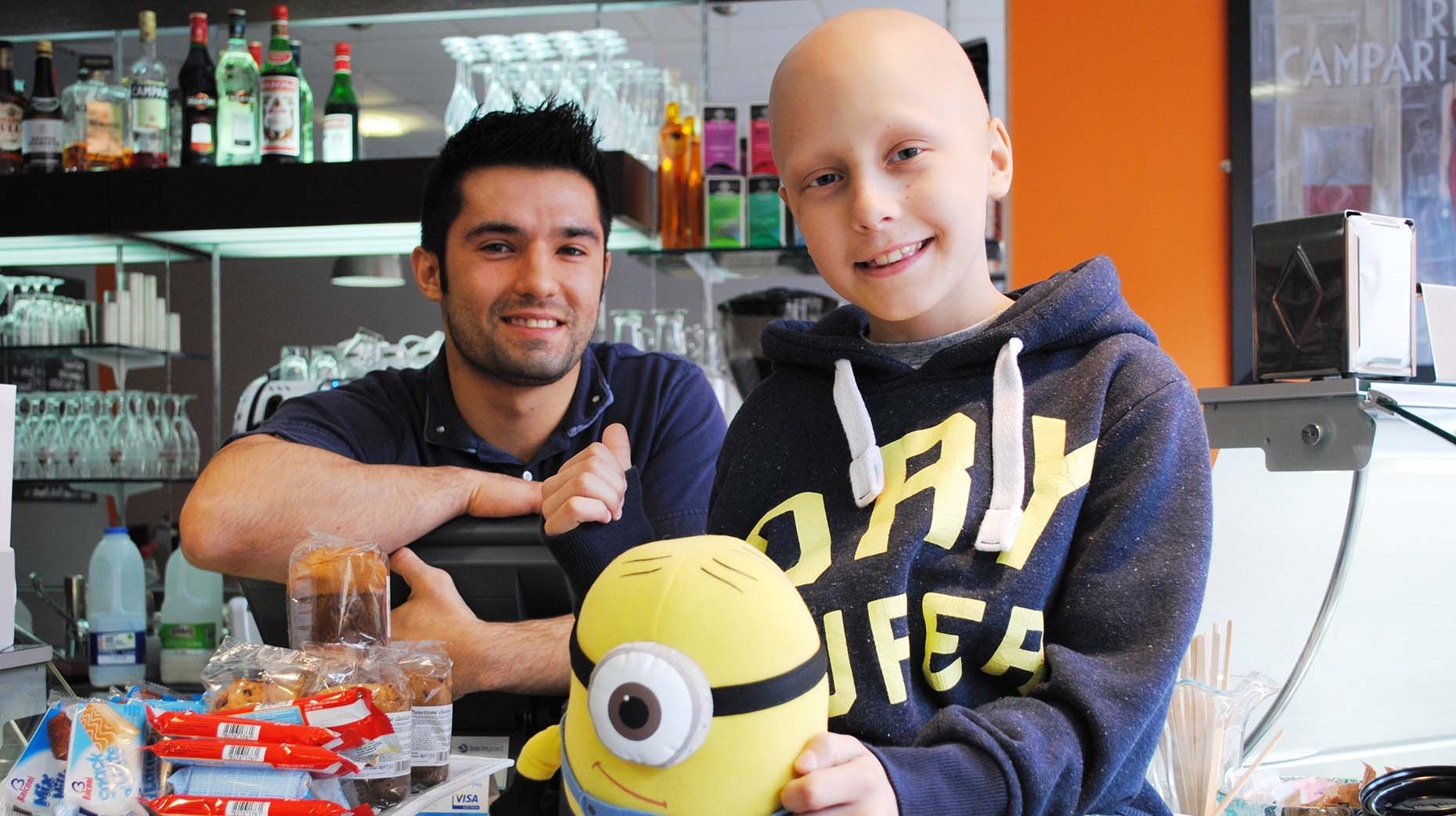 Bar Unico owner Gio Carchedi ran the Lincoln 10K dressed as a minion for 10-year-old Ethan Maull. Photo: Shooting Star