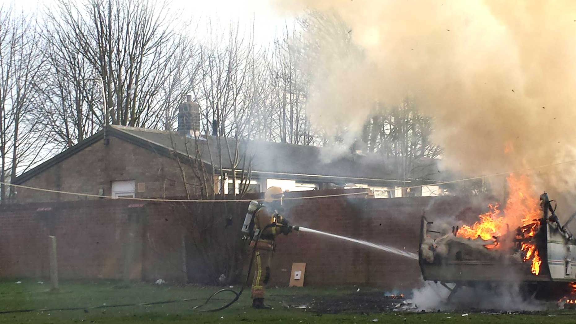 Thick white smoke while firefighters extinguished the caravan on fire in Lincoln. Photo: Nigel Mulhall