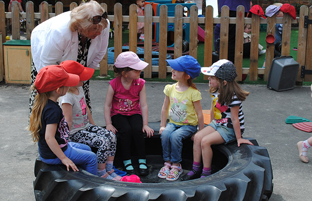 Margaret Mason meets children at The Old Station Nursery. Photo: Shooting Star