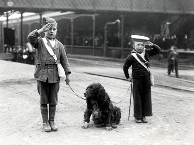 Two young boys saluting troops at Lincoln Central. Photo: via BBC