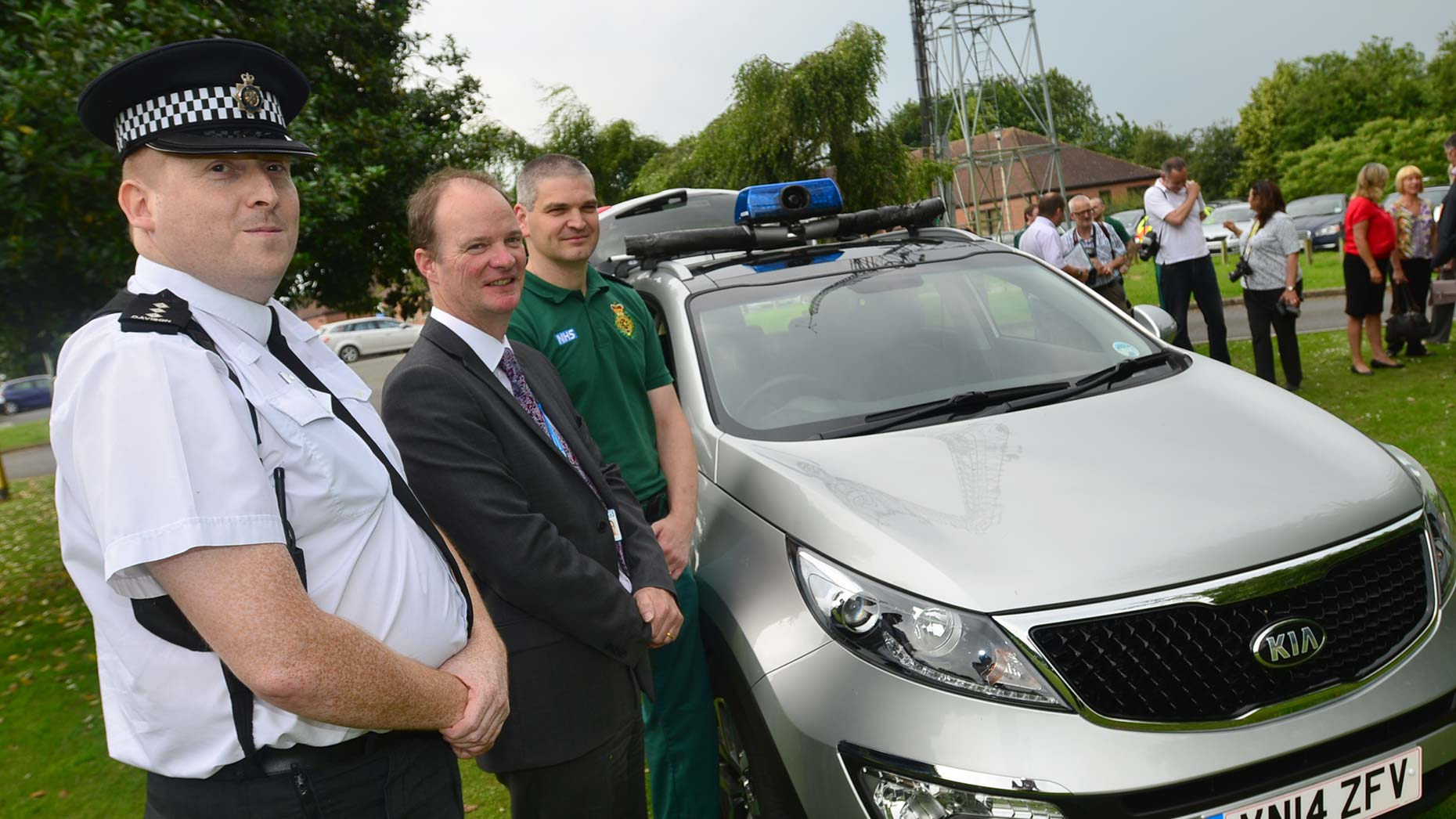Lincolnshire Police Chief Inspector Chris Davison, Dr John Brewin, Interim Chief Executive at Lincolnshire Partnership NHS Foundation Trust and EMAS Locality Quality Manager Paul Benton with the new street triage vehicle. Photo: Steve Smailes/The Lincolnite