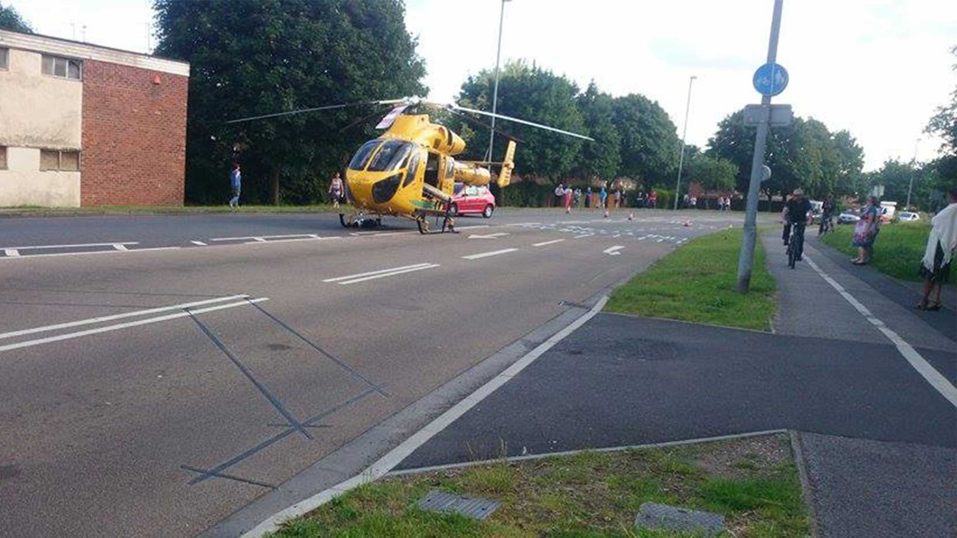 The ambucopter landed on the road to pick up the injured biker. Photo: Rex Helley