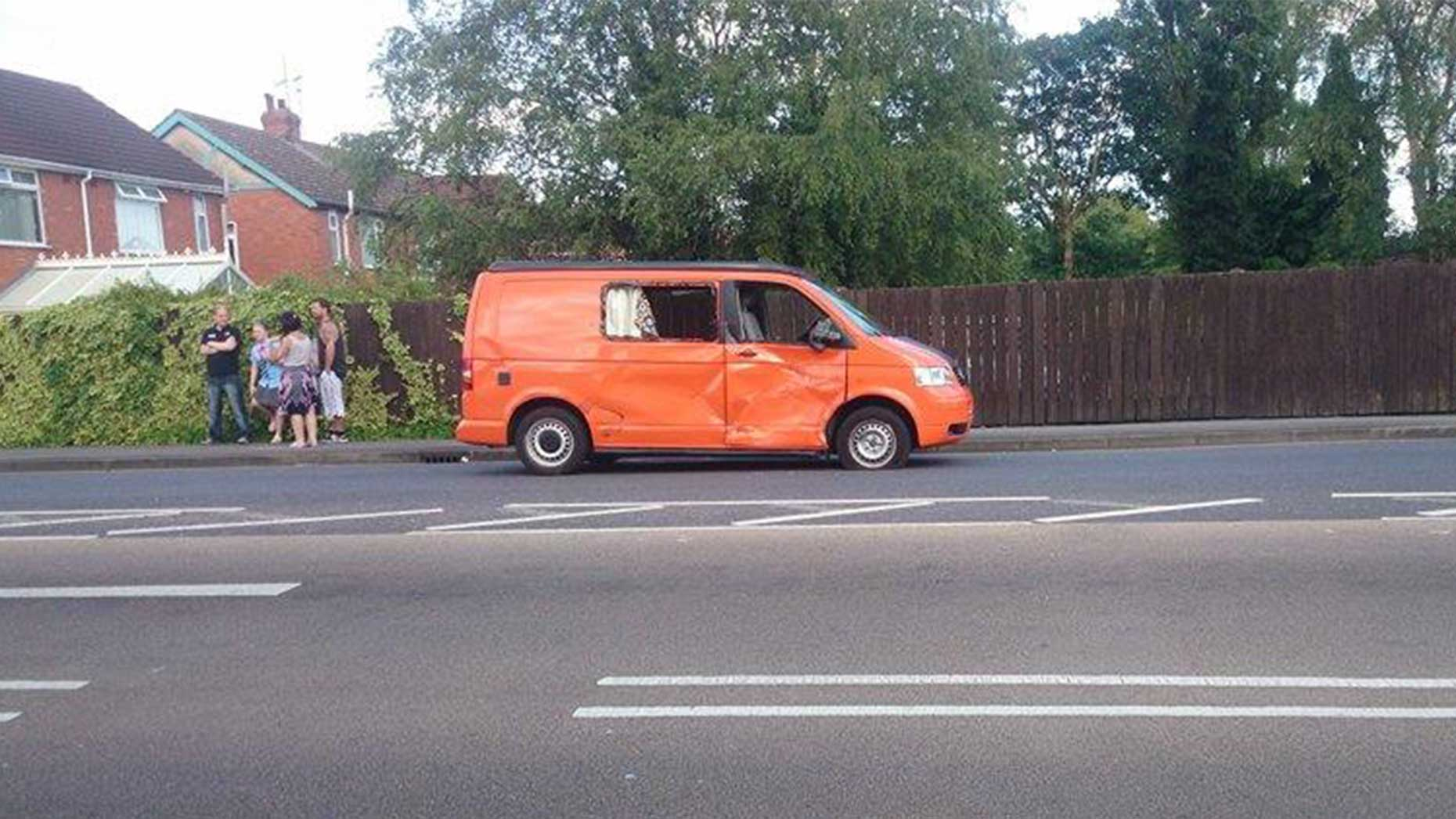 An orange van was also involved in the collision. Photo: Rex Helley