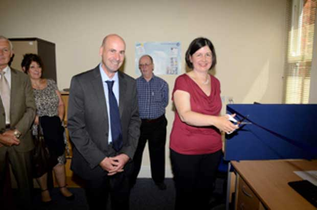 Cllr Rosie Kirk officially opens the Community Online suite at Lincoln and District Citizens Advice Bureau watched by outgoing chief officer Neil Clurow. Photo: Bryan Hurt.
