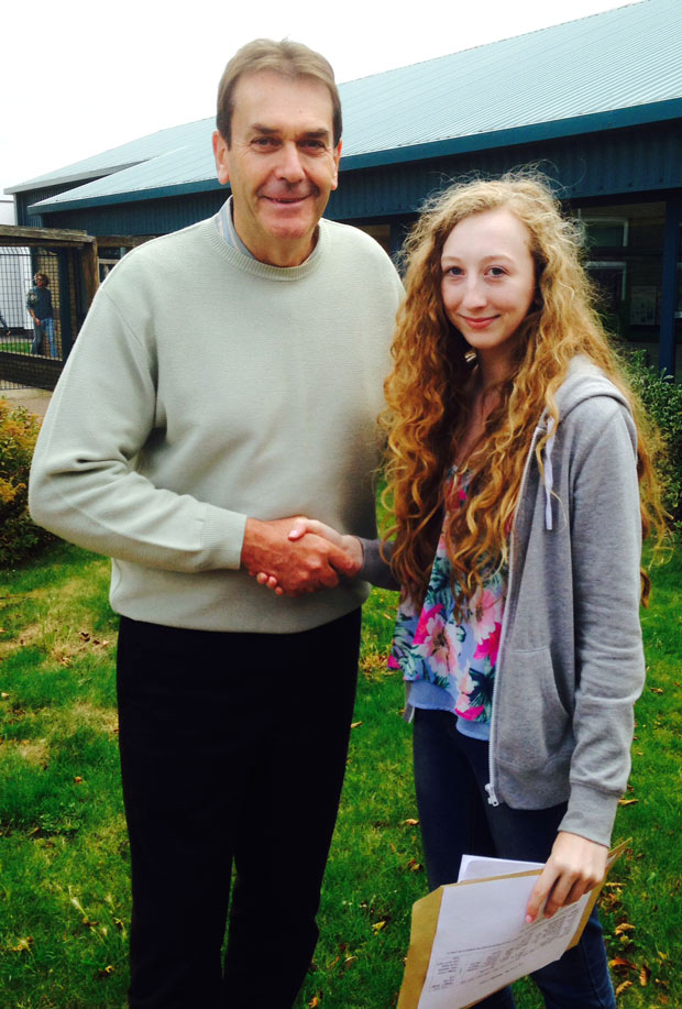 Head Teacher Martin Connor and student Leona Wilson who achieved an outstanding 11 A* grades.