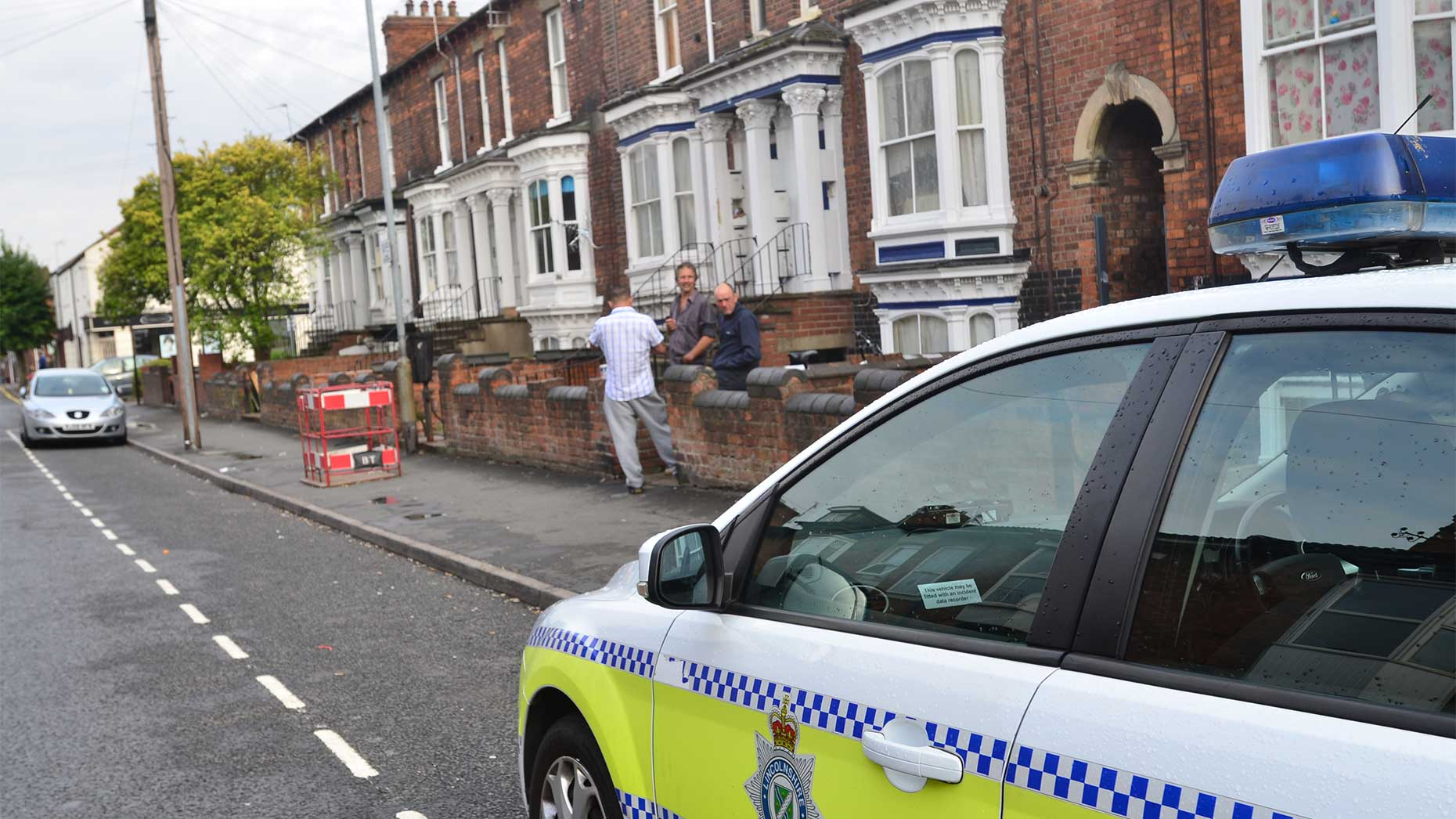 Police at the scene of the incident on Portland Street.