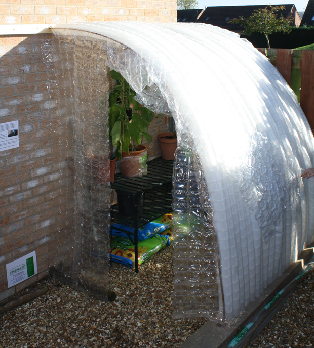 The greenhouse is made with: 1,035 milk bottles; 40 garden canes donated by Hykeham DIY; timber donated by RJ Laskey Joinery, and bubble wrap donated by Wirtgen Ltd.