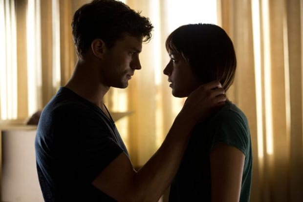 Dakota Johnson and Jamie Dornan in Fifty Shades of Grey (2015). Photo: Chuck Zlotnick for Universal Pictures