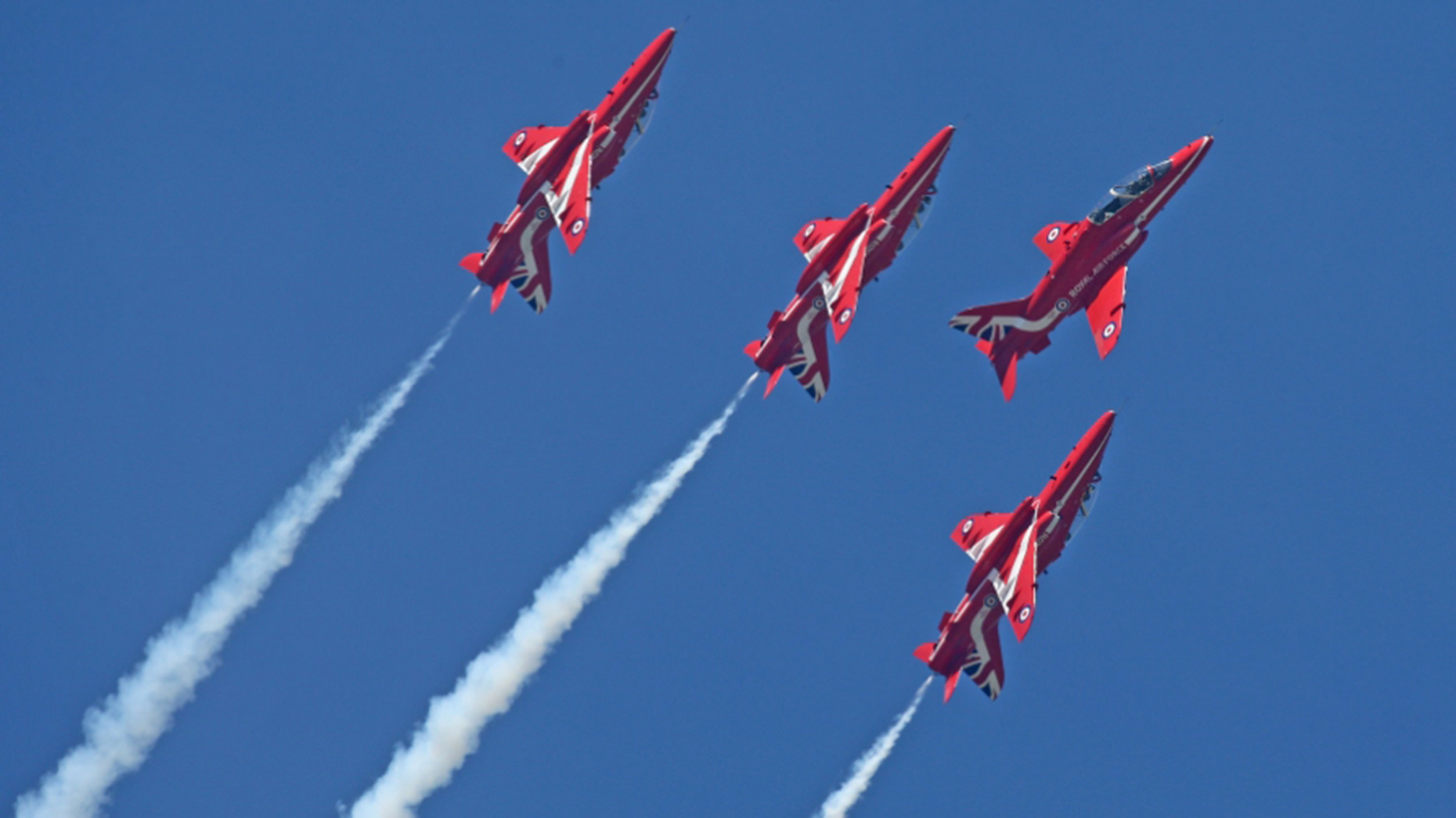 Jets of the Royal Air Force Aerobatic Team, the Red Arrows, showing their new Union flag tailfin. MoD/Crown Copyright