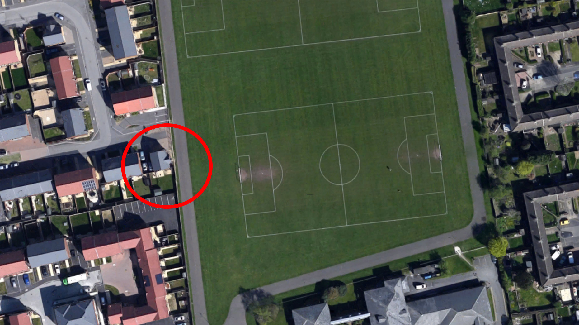 Daniel's house (circled) pictured from above next to the former junior pitch. Its now been extended to full size with the goal just metres from his home.