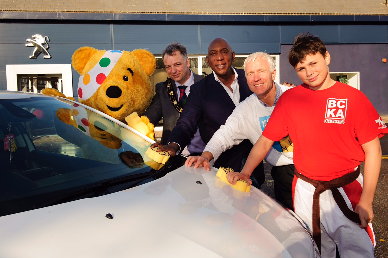 Pictured is, from left, Pudsey Bear, Mayor of Lincoln Councillor Andy Kerry, Colin McFarlane, Abacus Lincoln dealer principal Jason Harvey and Shea Couling