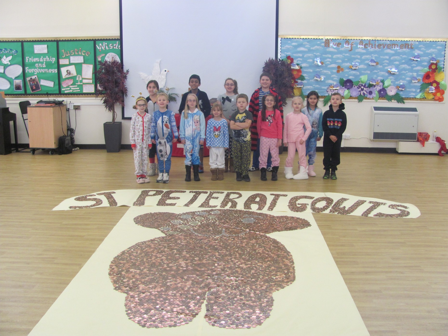 St Peter at Gowts dress in PJs and covered Pudsey in coins for Children in Need.