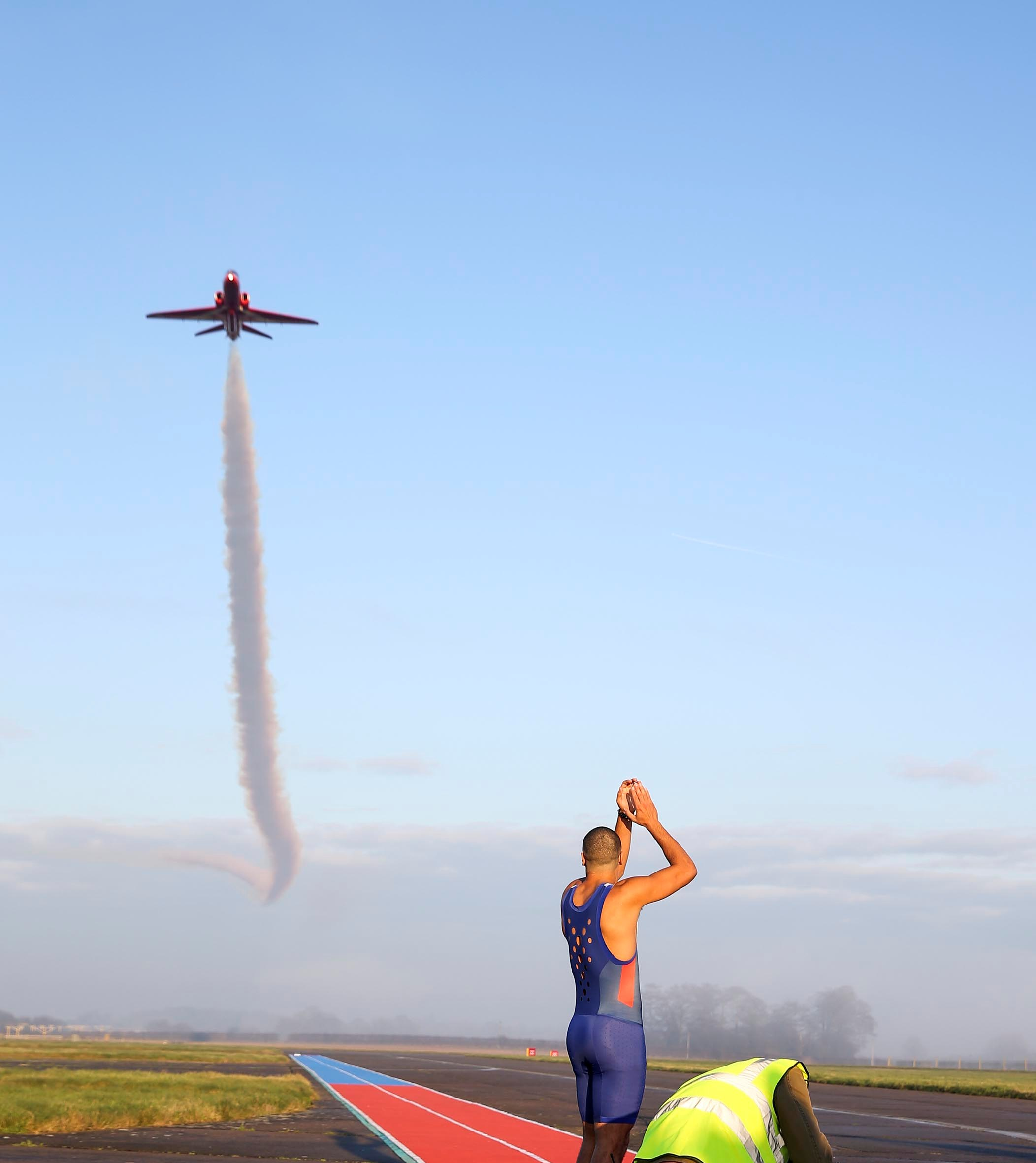 """ITV came to RAF Scampton over several days to film the new tv program """"Its Not Rocket Science"""". British 200m runner Adam Gemili raced a Red Arrows Hawk aircraft over a 100m distance. Presenters Romesh and Rachel Riley watched from the side of the runway. Image created by SAC Gina Edgcumbe"""