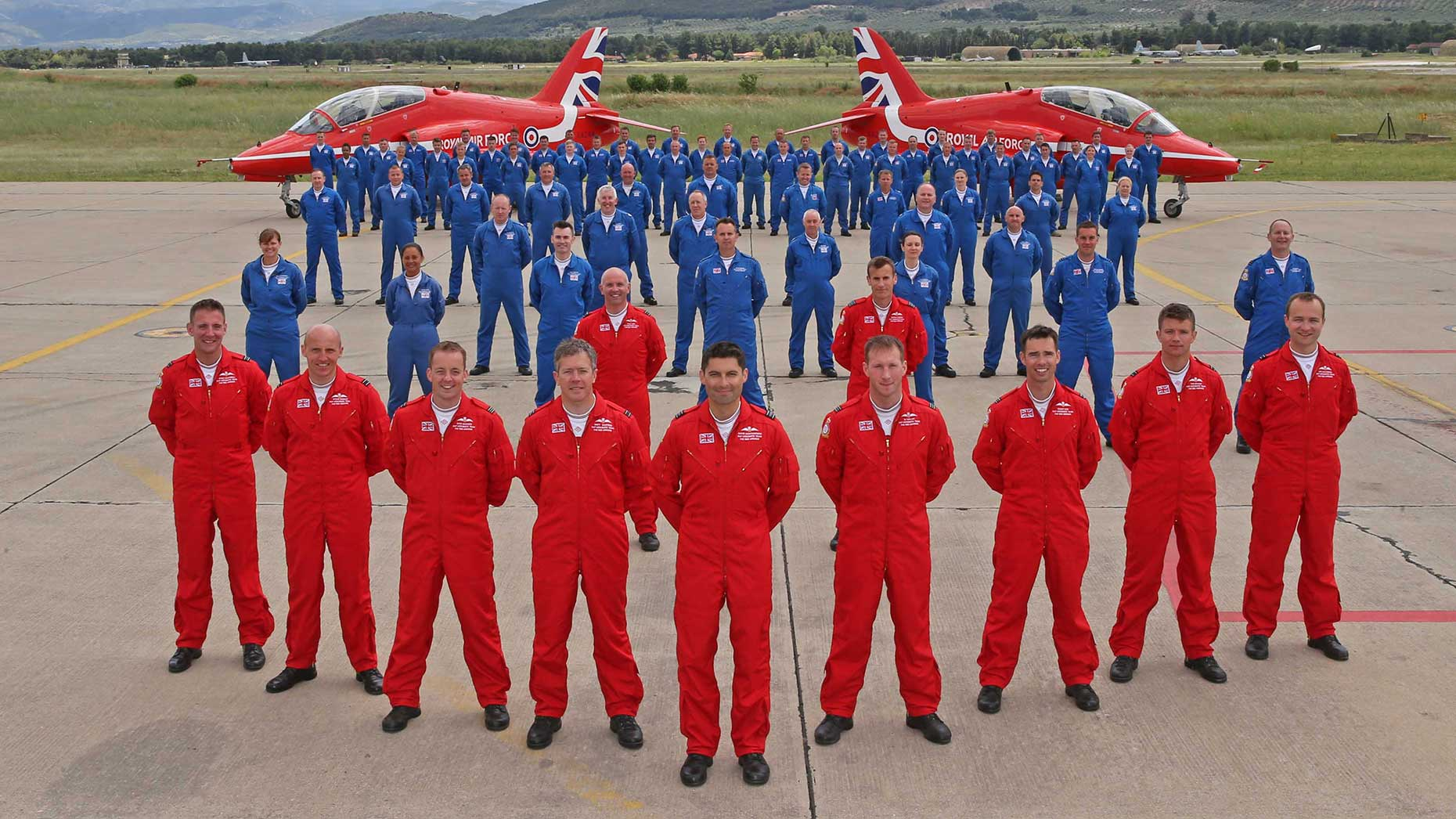 The Red Arrows pilots and ground crew wear their distinctive red and blue flying suits in Greece after the team successfully gained Public Display Authority for 2016. Photo: SAC Adam Fletcher, MoD/Crown Copyright 2016.
