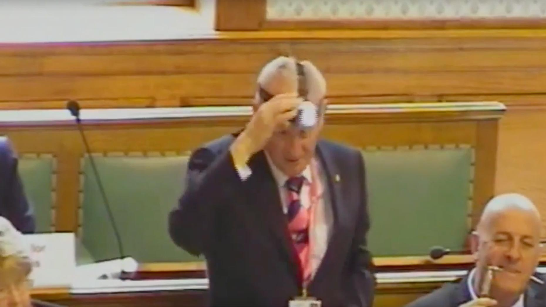 Councillor Robin Renshaw wears a head torch in protest at switching off lights at night in Lincolnshire