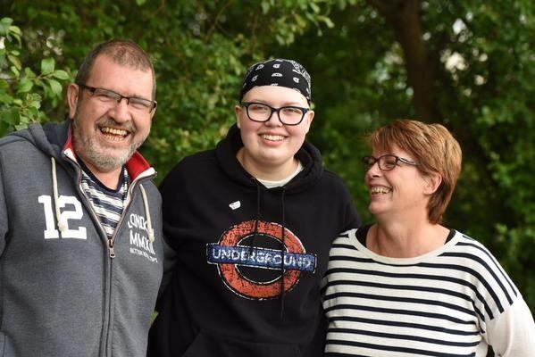 Natasha with her parents.