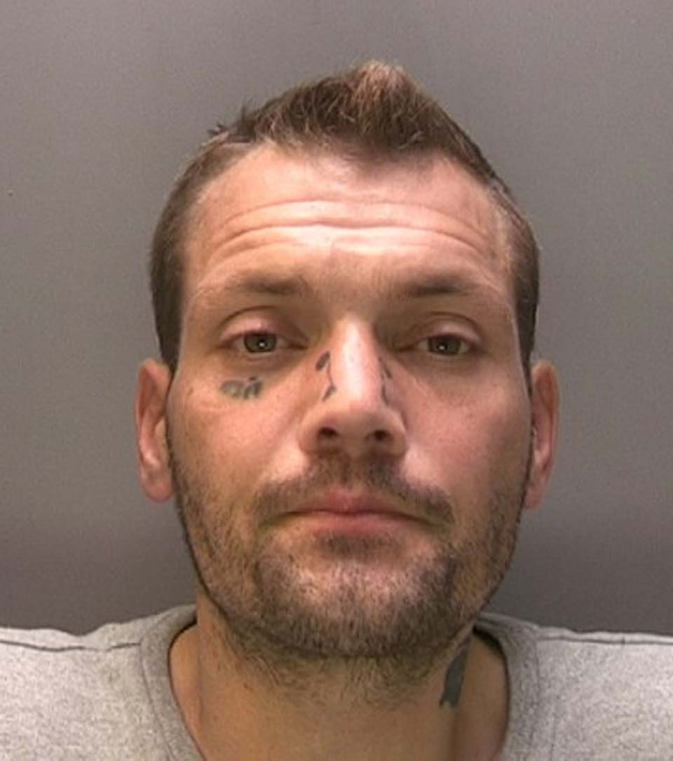 """Mark McKenzie has distinctive facial tattoos of """"oi!"""" under his eye and two mini scrolls either side of his nose. Photo: Lincolnshire Police"""