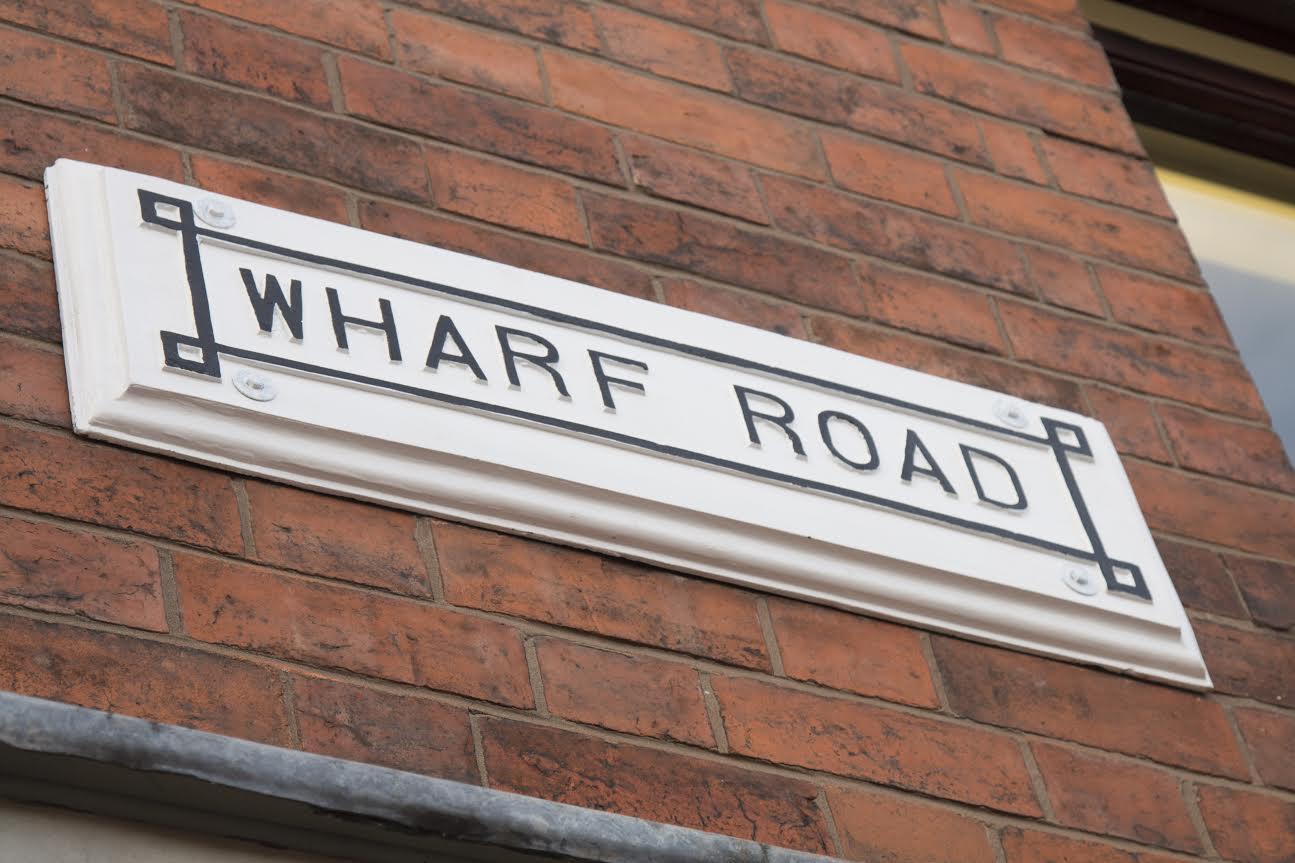The refurbished Wharf Road sign.