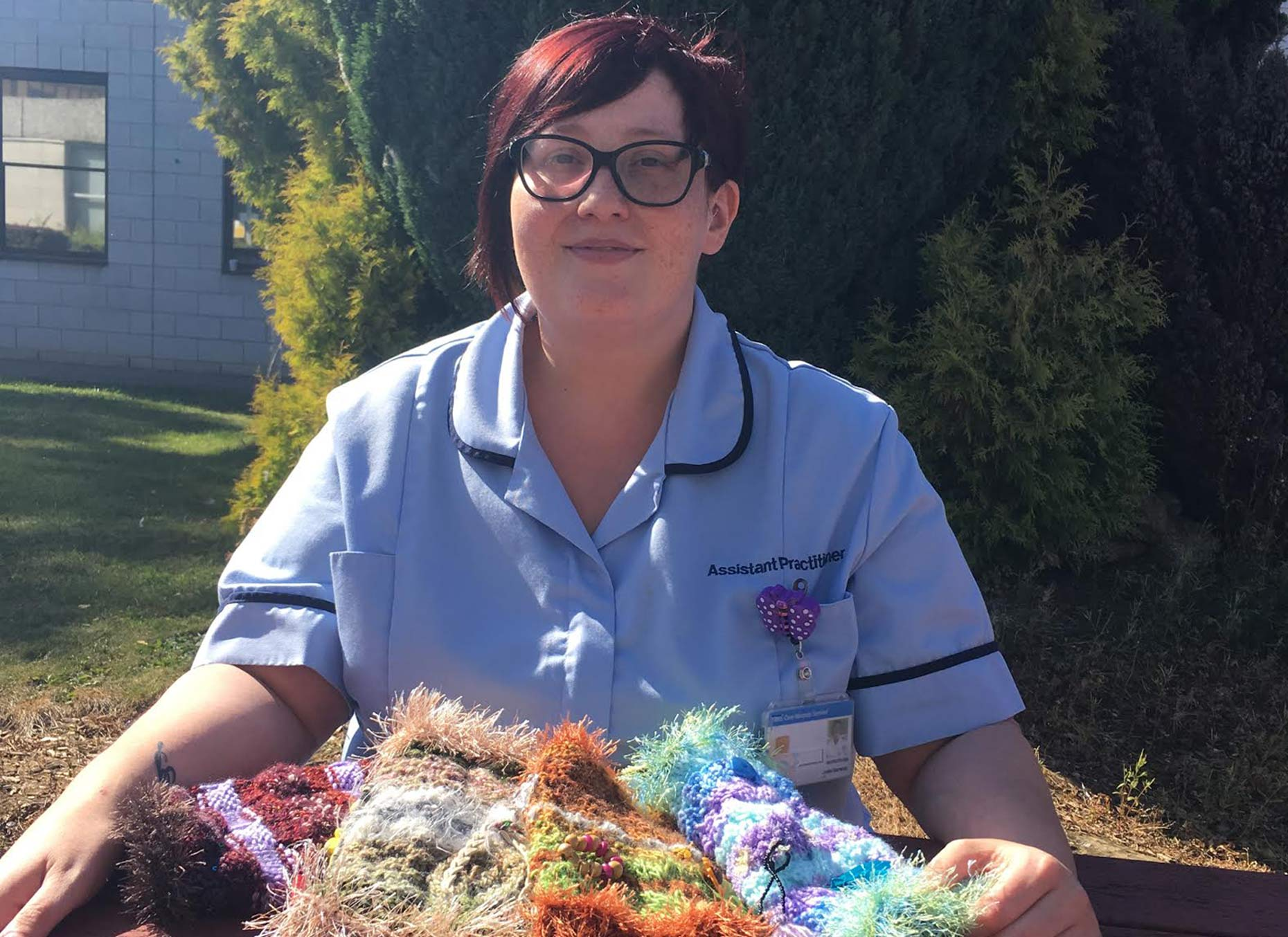 Jodie, with fiddle blankets and twiddle muffs, which are used by patients who are distressed.
