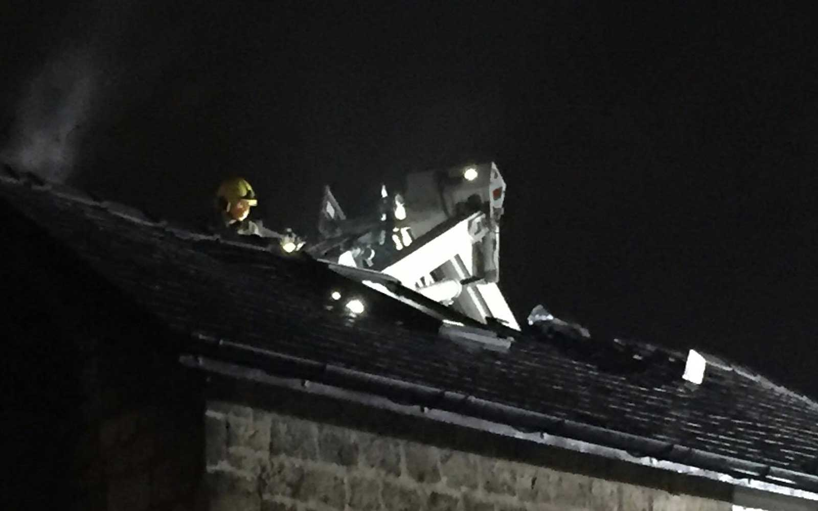 The damage to the roof after the fire was extinguished.